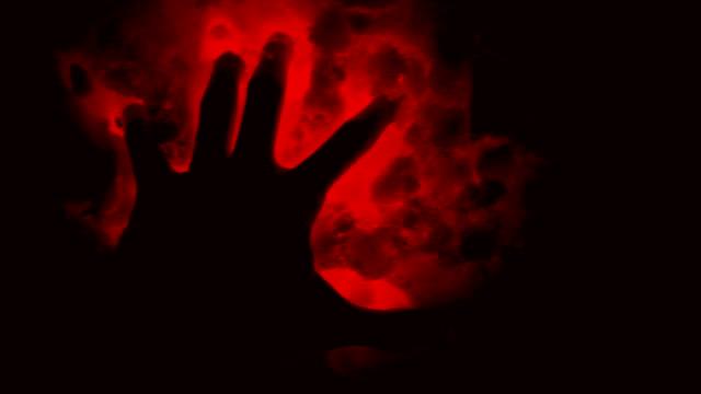 forntida utomjordingar tecken. mörka hand i röda onda snön. - stavning bildbanksvideor och videomaterial från bakom kulisserna