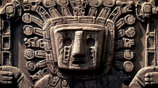 Ancient Aztec Stone Carving Closeup of an ancient Aztec carving of a face in the rock statue stock videos & royalty-free footage