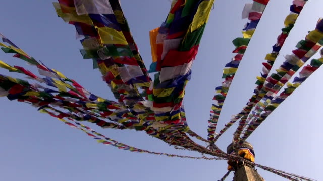 ancient Boudhanath stupa with buddhist flags in Katmandu video