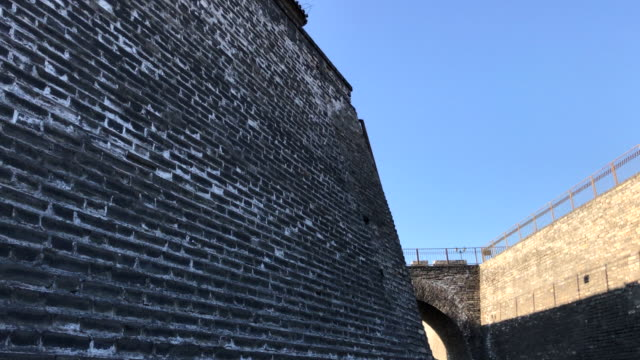 ancient brick wall at ming dynasty wall relics park , beijing , china. - ming video stock e b–roll