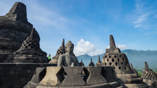 Ancient Buddha statue and stupa at Borobudur temple in Yogyakarta, Java, Indonesia. 4K Time-lapsed of Ancient Buddha statue and stupa at Borobudur temple in Yogyakarta, Java, Indonesia. jakarta stock videos & royalty-free footage