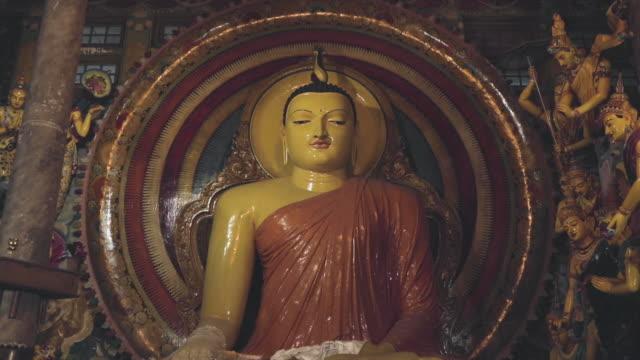 ancient buddha statue in temple - buddha video stock e b–roll