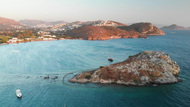 ancient city myndos on rabbit island and gumusluk seaside, bodrum, turkey - morze egejskie filmów i materiałów b-roll