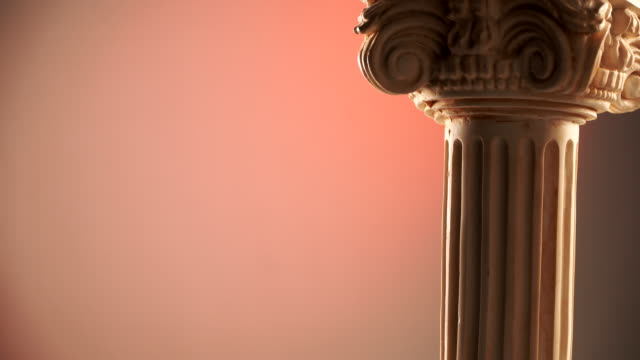 ancient column rotating on color background - greek architecture stock videos & royalty-free footage