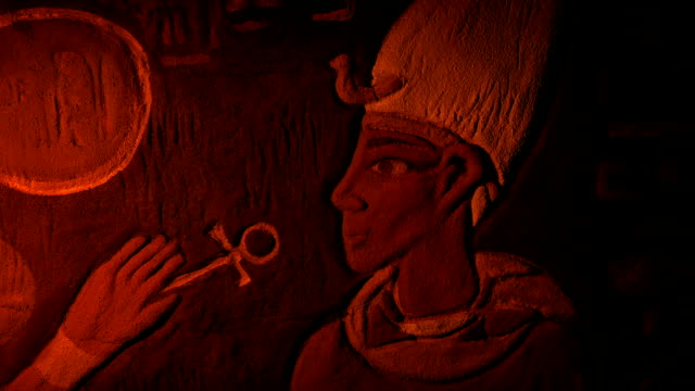 Ancient Egypt Painted Wall Art Lit Up With Torch