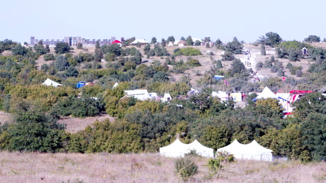 ancient fortress with tents on a hillside video