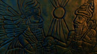 istock Ancient Gods Wall Carving Moving Shot 1208378800
