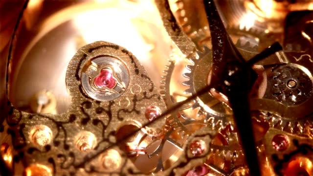 Ancient gold clock mechanism gear video