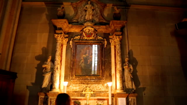 Ancient icon of the Mother of God with child at Zagreb cathedral, woman praying video