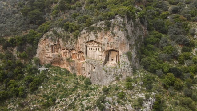 Ancient Lycian Rock Tombs of Dalyan, Mugla, Turkey Lycian rock tombs of Kaunos in Dalyan which is a town in Mugla Province located between the well-known districts of Marmaris and Fethiye on the south-west coast of Turkey. old ruin stock videos & royalty-free footage