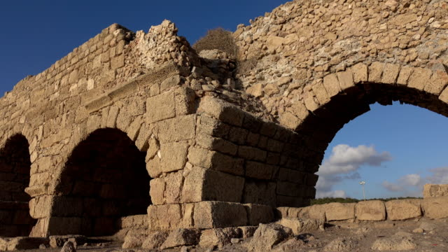 Ancient Roman Aqueduct in Ruins in Israel Israel, Caesarea - Ocean, Aqueduct aqueduct stock videos & royalty-free footage