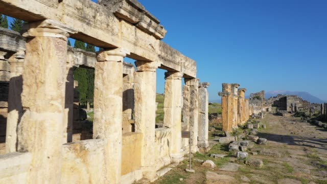 Ancient ruins of Hierapolis Pamukkale Ancient ruins of Hierapolis Pamukkale - Denizli - Turkey. greek architecture stock videos & royalty-free footage
