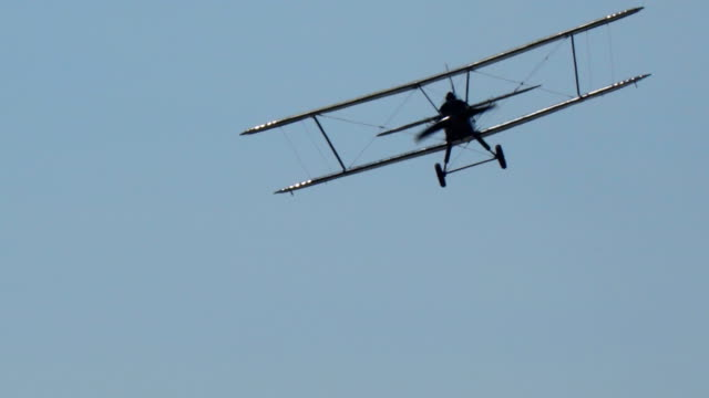 Ancient Russian aircraft biplane An2 flying in the blue sky video