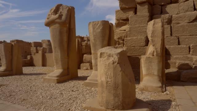 ancient sculptures of karnak temple in luxor. egypt - египет стоковые видео и кадры b-roll
