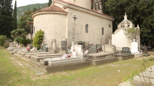 Ancient stone cemetery in Montenegro, Kotor. The chapel and the grave of an old abandoned cemetery.