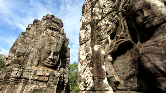 ancient stone faces bayon temple, angkor wat, siam reap, cambodia - cambogia video stock e b–roll