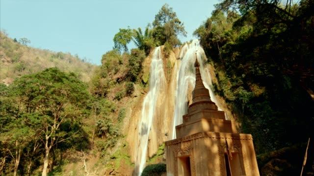 ancient temple near waterfall - myanmar video stock e b–roll