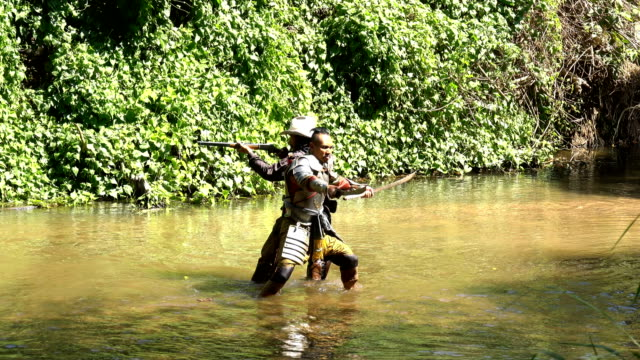 Ancient Warrior Fighting Together With Cowboy In The River