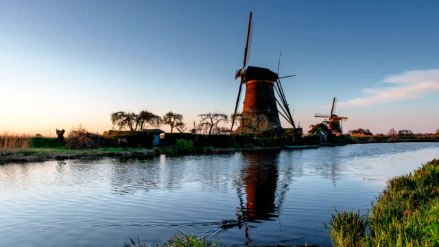 ancient windmills on riverbank. beauty of holland. world most picturesque places. old engineering constructions - rotterdam video stock e b–roll