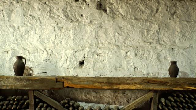 ancient wine bottles dusting in an underground cellar video