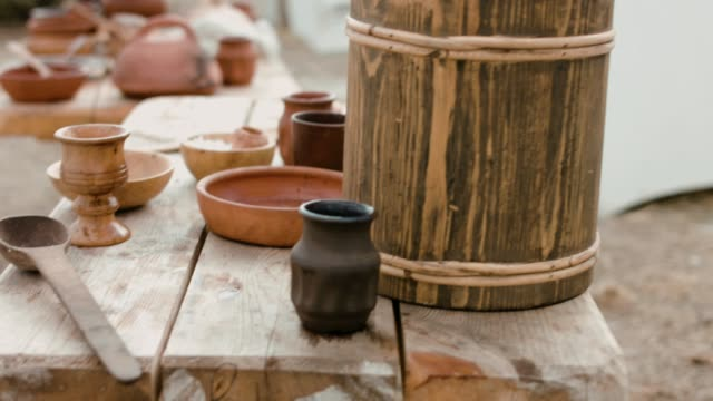 Ancient wooden and clay dishes left on the table after dinner video