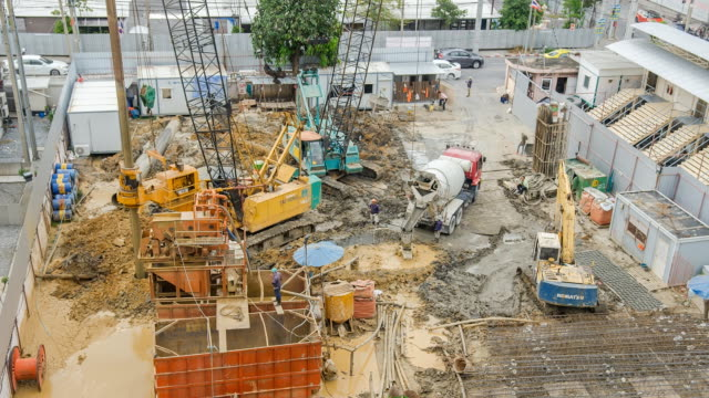 TL and aerial view : Machinery dig hole under construction Site. video