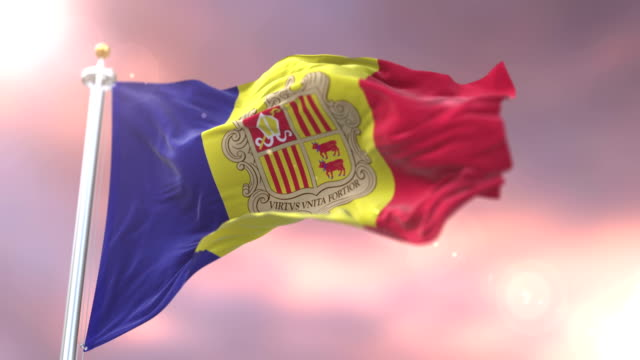Andorra flag waving at wind in slow at sunset, loop video