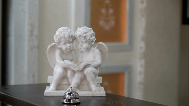 Angels statuette with ring on a reception desk video