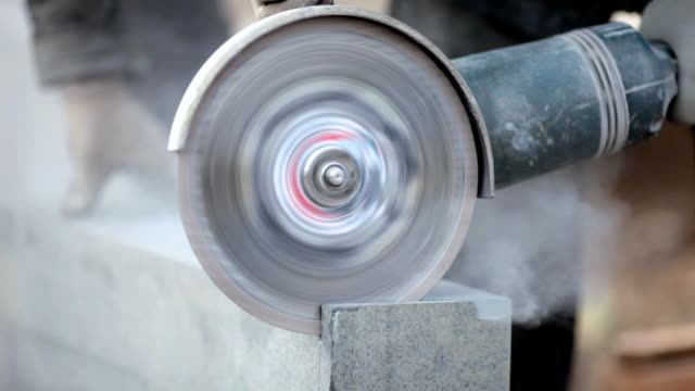HD: Angle grinder The worker cuts a stone a angle grinder grinder industrial equipment stock videos & royalty-free footage