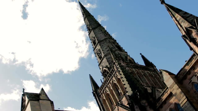 angled shot showing the gothic architecture of lichfield cathedral - gargoyle video stock e b–roll