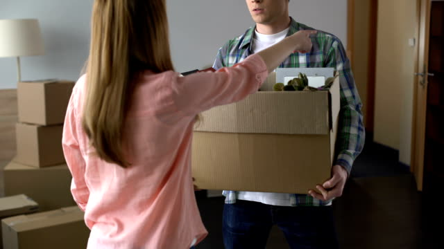 Angry and offended woman expelling man with all stuff out of house, break-up Angry and offended woman expelling man with all stuff out of house, break-up relationship breakup stock videos & royalty-free footage