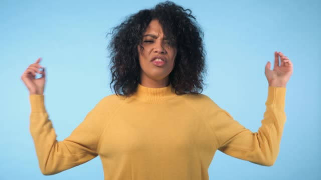angry annoyed woman raising hand up to say no stop. sceptical and distrustful look, feeling mad at someone. afro girl facial expressions, emotions and feelings. body language - gusto aspro video stock e b–roll