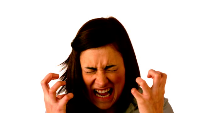 Angry brunette shouting on white background video