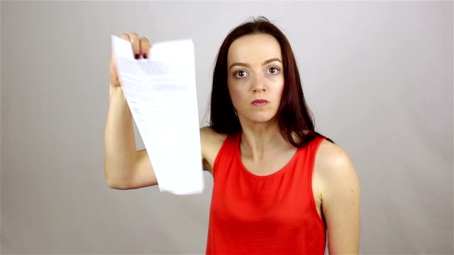 Angry business woman cancels the contract. Breaking paper video