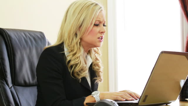 Angry business woman with laptop video