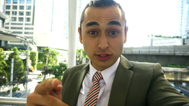 Angry businessman making a video call video