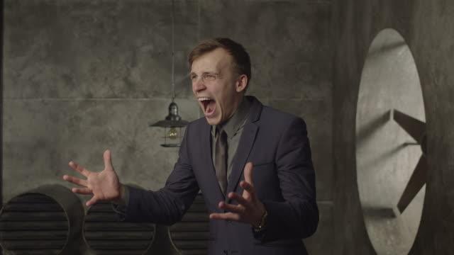Angry businessman screaming loud in despair