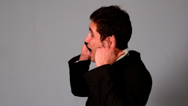 stockvideo's en b-roll-footage met angry businessman shouting on the phone - overhemd en stropdas