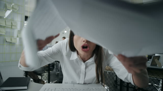 Angry businesswoman throwing papers video