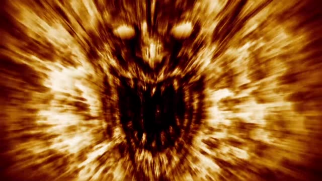 angry demon face screams in fire. - inferno video stock e b–roll