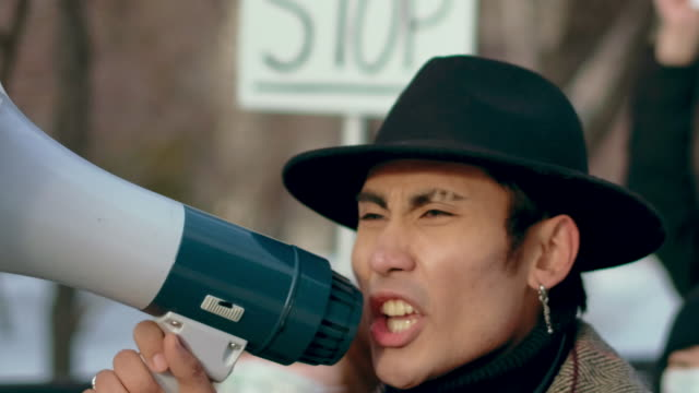 Angry Guy Walk Shout Loudspeaker Closeup. Aggressive People Strike Resistance