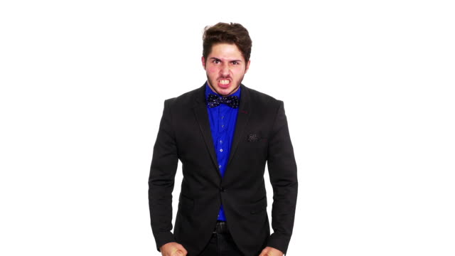 angry handsome elegant guy on white background - pugno video stock e b–roll