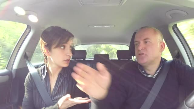 Angry Husband And Wife Having An Argument Traveling By Car video