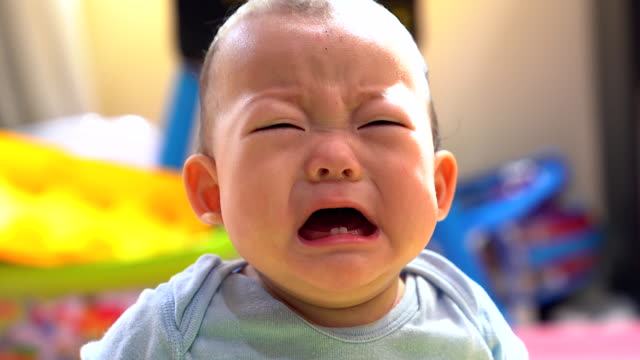 Angry little baby with sad expressions, screaming and crying. video