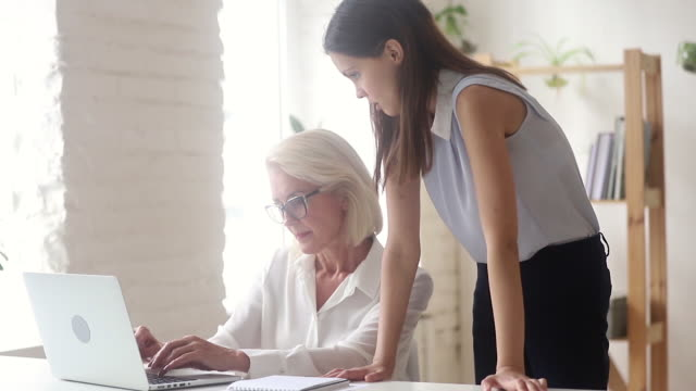 Angry millennial ceo explains stressed elderly employee online task