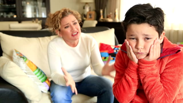 Angry mother scolding a disobedient child video