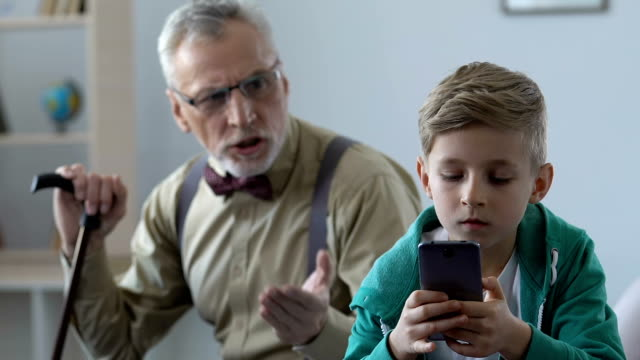 Angry Old Man Scolding Grandson Playing Smartphone Game Family