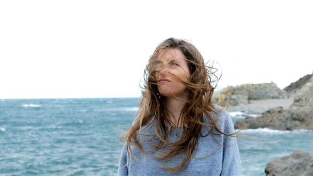 angry teen with tousled hair in a windy day - spettinato video stock e b–roll