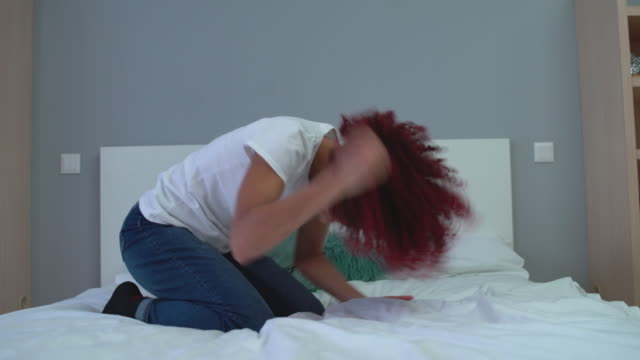 Angry teenager punching pillow, feeling desperate, stress release, problems
