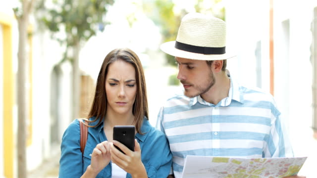 Angry tourists using a spoiled smart phone
